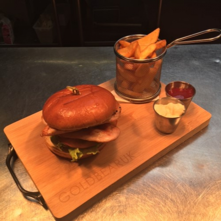 chicken burger served with chips and sauces